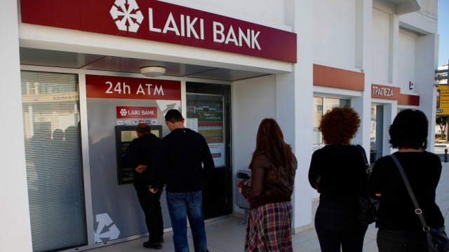 Panicked depositors form queues at Cypriot ATMs